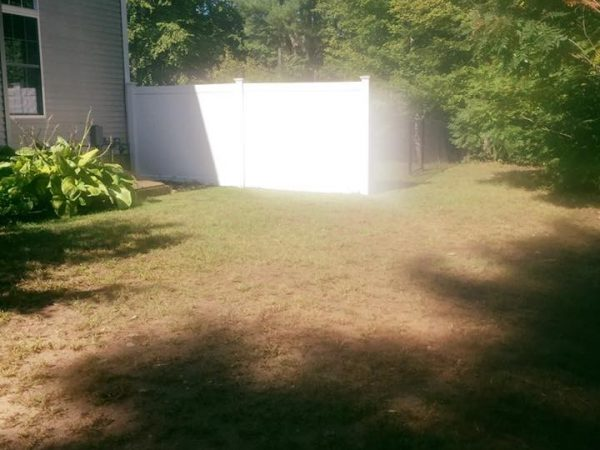 Derry NH storm cleanup job after photo, with with lawn care all completed.